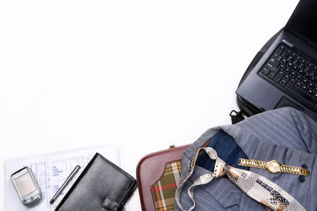 All business travelling items framing white background photo
