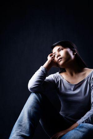 Portrait of woman contemplating in dark Stock Photo - 4787761