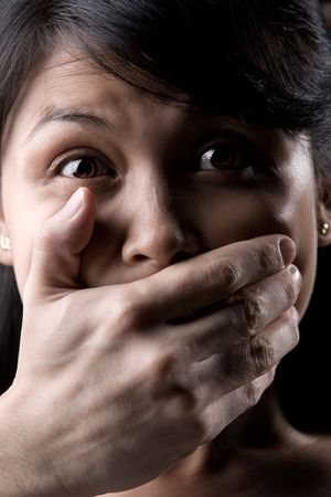 silenced: Young woman is being silenced
