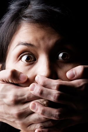 silenced: A young woman is being kidnapped or silenced Stock Photo