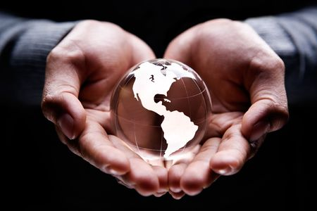 Hands holding a glass globe showing America continent photo