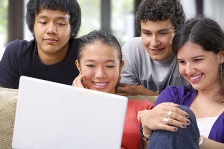 A group of multi ethnic student watching the laptop