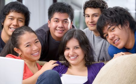 youthful: Multi-ethnic students in pose together showing their youthful and friendship