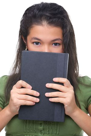 hard cover: A female teenager hiding half her face behind hard cover book.