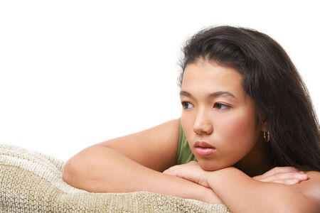 looking away from camera: A female teenager pose on the sofa looking away from camera