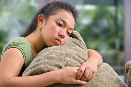 sad girl: Expression of lonely female teenager at home