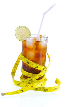 soft drinks: A glass of soft drinks surrounded by tape measure, isolated on white Stock Photo