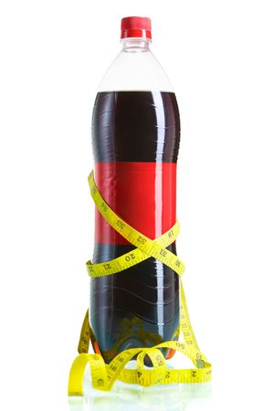 A bottle of cola surrounded by tape measure, isolated on white