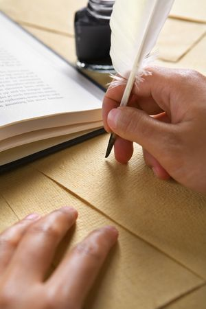 Hand writing on old parchment / paper using quill pen Stock Photo - 5129144