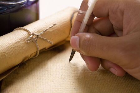 Hand writing on old parchment / paper using quill pen Stock Photo - 5129093