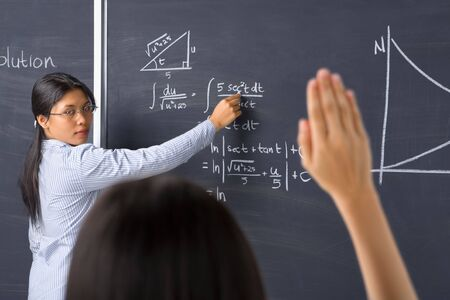 A student asking to the teacher about mathematics photo