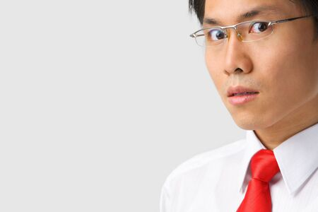 A young Asian businessman gazing at camera with lot copy space Stock Photo - 5128057
