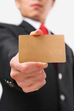 Businessman showing golde credit card to camera Stock Photo - 5128036