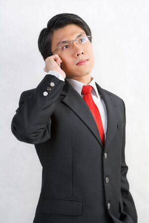 A young Asian businessman talking on his cell phone photo