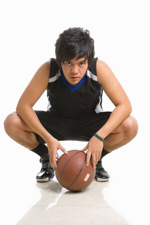 knee bend: Basketball player bend on knee with the ball Stock Photo