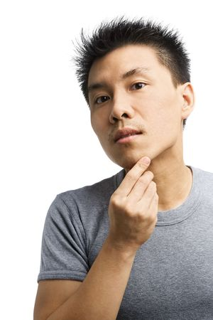 Portrait of Asian man looking his unshaved chin Stock Photo - 5386684
