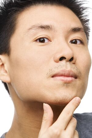 unshaved: Close up portrait of Asian man looking his unshaved chin Stock Photo