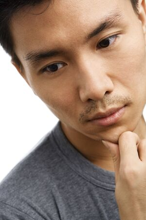 Portrait of sad expression of Asian young man photo