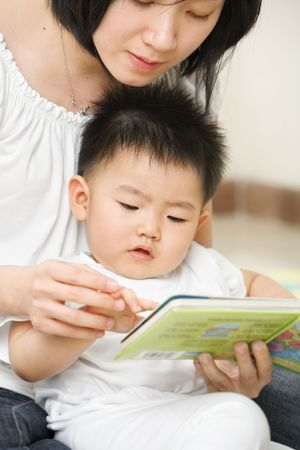 tutoring: Asian mother tutoring her son for early education