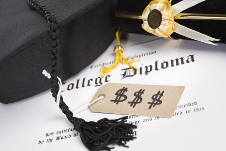 Concept of expensive education that diploma with tassel and price tag photo