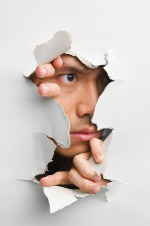 Man looking away from cracked wall - one of the breakthrough series Stock Photo - 5468930