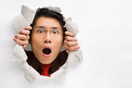 Man gazing surprisingly from hole in wall with copy space in horizontal position Stock Photo - 5468846