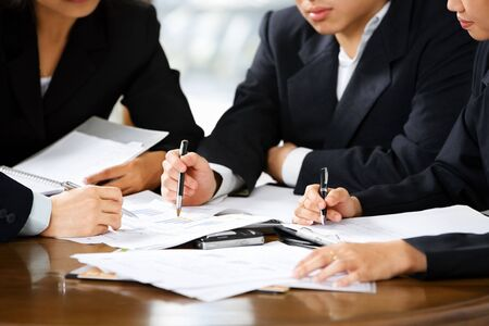 cohesive: Discussion between businesspeople in office Stock Photo