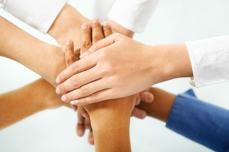 multi colored hand of people hand in unity to express togetherness in community Stock Photo - 5468957