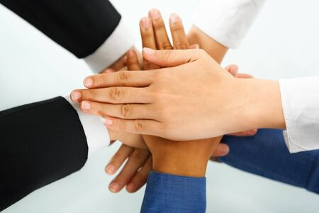 A leader hands and his meployess hand in unity to express teamwork photo