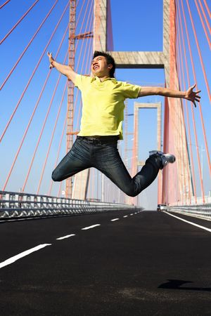 ps: Young man jump very high in bridge area in the morning *** PS: showing blur movement even in face area***