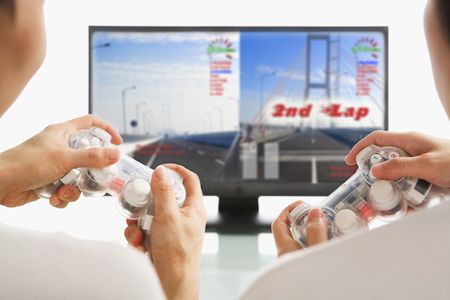 gamepad: Two men playing racing game, with their hands holding game-pad. The image and design on screen are mine. Stock Photo