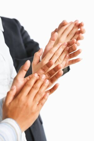 clapping hands: Three unrecognizable people giving applause over white background Stock Photo