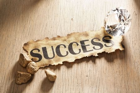 Success concept using burnt paper with word success printed on it, diamond and gold rock around it Stock Photo - 5557678
