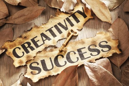 Creativity is key to success concept using words printed on burnt paper and related objects, surrounded with dry leaf Stock Photo - 5557706