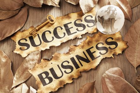 Key to success in global business concept using words printed on burnt paper and related objects, surrounded with dry leaf Stock Photo - 5557691
