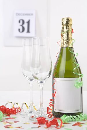 Champagne on new year eve with calendar on background photo