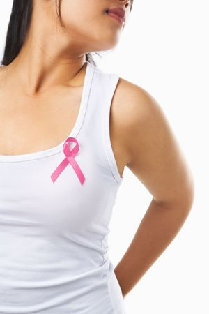Woman using pink ribbon on her chest to support breast cancer cause or AIDS. PS: yo can change ribbon color to red to support AIDS cause as both using same symbol Stock Photo - 5557673
