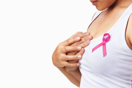 Woman hold another hand to embrace her breast. Concept to support breast cancer cause Stock Photo - 5678466