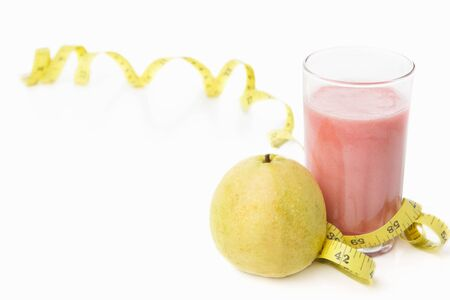 Guava and a glass of juice with measuring tape for diet and healthy life concept with lots of copy space photo