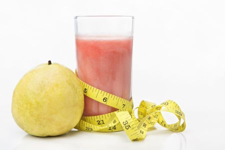A glass of guava juice with fresh ones on white table Stock Photo - 5678488