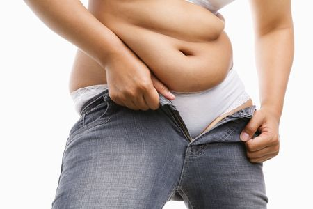 tight jeans: Fat woman body trying to put on her tight jeans, a concept to get a diet. Stock Photo