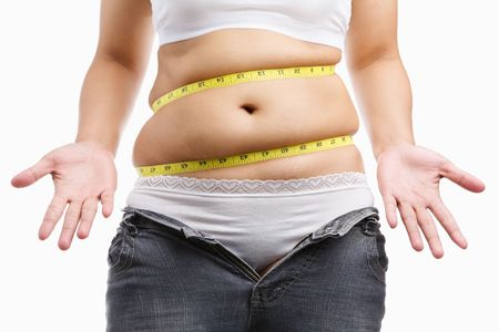 belly fat: Fat woman give up wearing her tight jeans with measuring tape around her belly, a concept to start diet Stock Photo