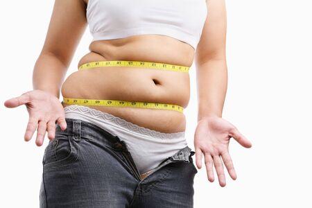 jeans apretados: Mujer grasa renunciar vistiendo sus estrecha vaqueros, un concepto para iniciar la dieta