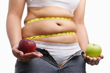 fat woman with unzip jeans holding apple, ac oncept to fight obesity by starting diet photo