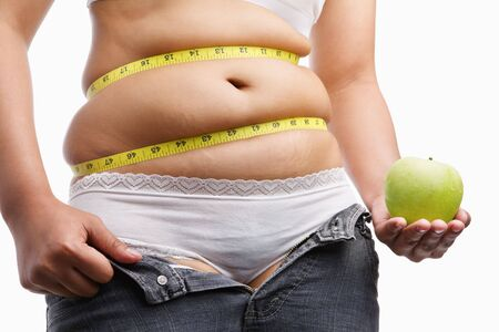 fat woman with unzip jeans holding apple, ac oncept to fight obesity by starting diet Stock Photo - 5715418