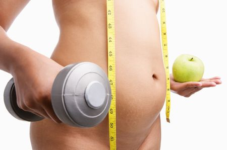 belly fat: Fat nude woman body holding apple and weight on each hand with measuring tape, is a concept to fight obesity.  PS: Stitched image Stock Photo