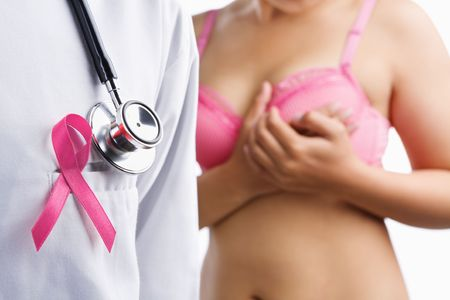 Doctor with pink badge and woman on pink bra on background, a aconcept for breast cancer