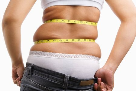 Female wearing jeans that already too small for her, concept to have diet photo