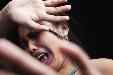 Young woman defending herself, can be used for domestic violence concept Stock Photo - 5836867