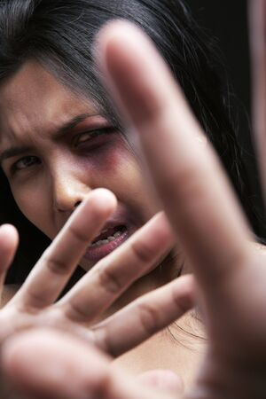 horrified: Young woman defending herself, can be used for domestic violence concept